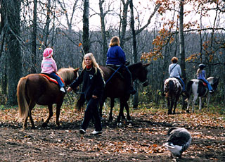 Children on a trail ride at Pine River Stable.